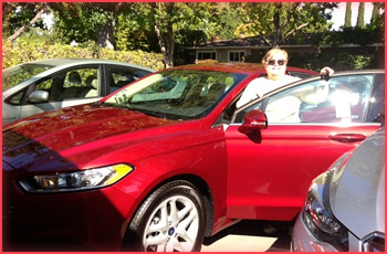 Marsha with her new car.